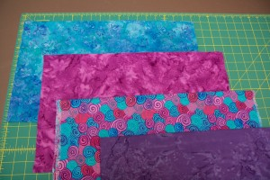 Select four fat quarters of four fabrics for the quilt top. They should be fabrics that go well together, but have some contrast between them.