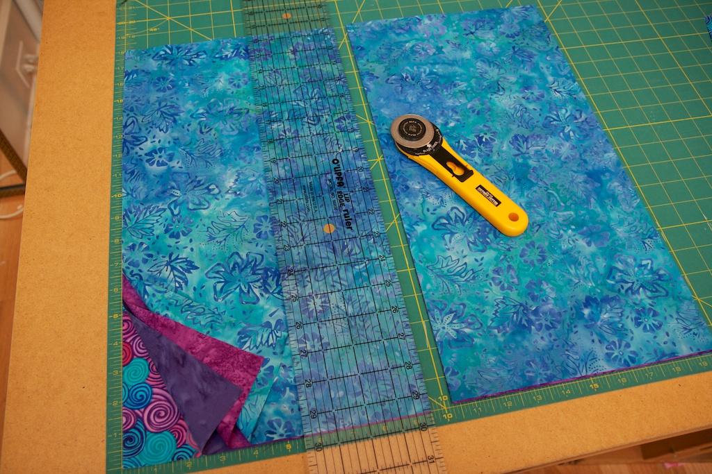 Cut a 18x9.5 inch strip from each fat quarter.