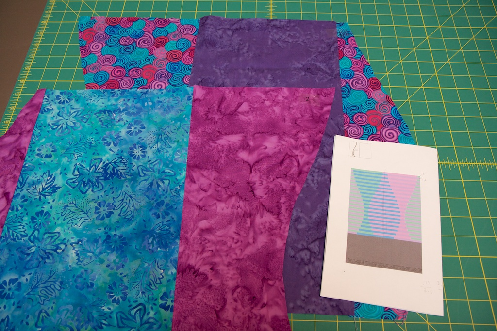 """Press all the seams to one side. You should now have two panels that are cut to match the curves in your design. To make it easier to keep track of your panels, place a piece of tape on each panel and label them """"1"""" and """"2."""""""