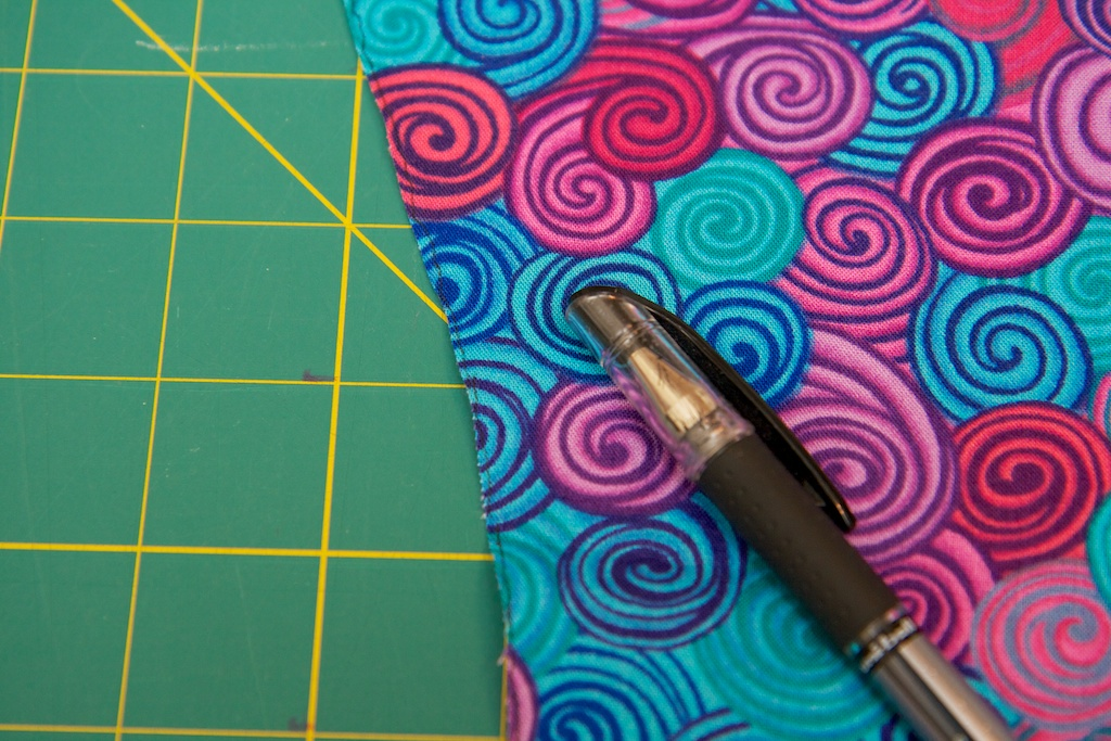 """Using your dark pen, draw a line down the left edge of the front side of each panel. Remember """"the Line is on the Left"""" so that you know how to orient your panels and strips when you sew them together."""