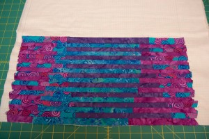Continue alternating between panel 1 and panel 2 strips until you cover the grid. You may have a couple extra strips left over. (To avoid leftover strips, your grid fabric should be at least .5-inch taller than your fabric tubes.)