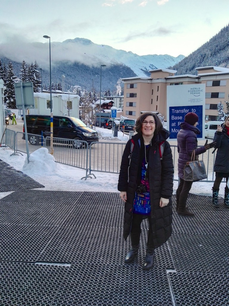 Lorrie with boots and long coat at transportation hub, WEF 2016